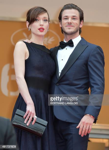 French actor Gaspard Ulliel and his partner Gaelle Pietri pose as they arrive for the screening of the film SaintLaurent at the 67th edition of the...