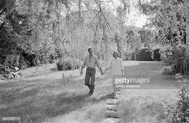 French actor Georges Descrières and his wife Nicky in their garden at home He was a member of the Comédie Française from 1958 to 1985