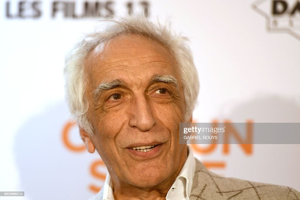 French actor Gerard Darmon poses during the photocall for the premiere of the film 'Chacun Sa Vie' in Paris on March 13, 2017. The film is directed by French director Claude Lelouch. /