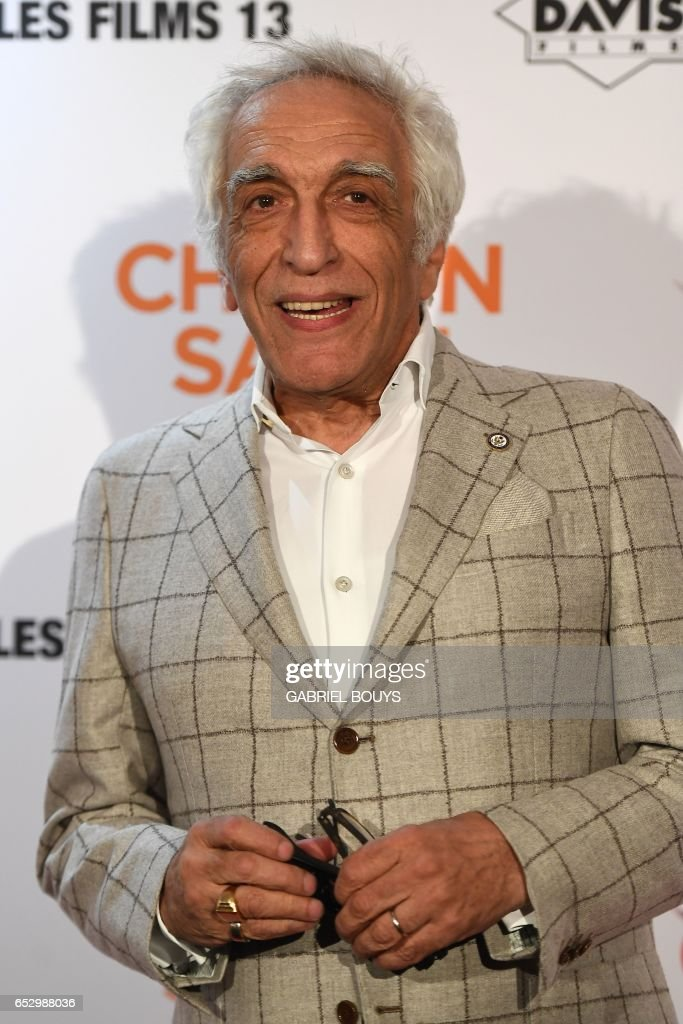 French actor Gerard Darmon poses during the photocall for the premiere of the film 'Chacun Sa Vie' in Paris on March 13, 2017. The film is directed by French director Claude Lelouch