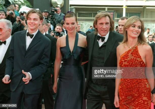 French actor Gerard Depardieu accompanied by French actresses Carole Bouquet Judith Godreche and US actor Leonardo DiCaprio upon arrival for the Palm...