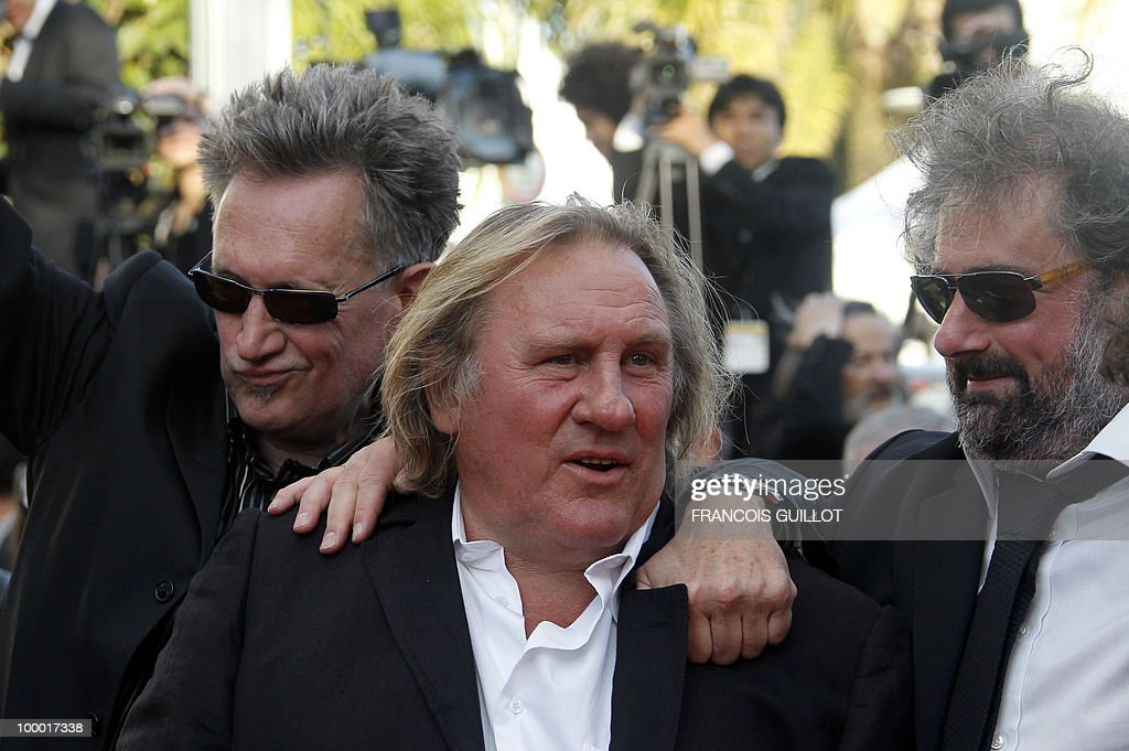 French actor Gerard Depardieu (C), actor and director Benoit Delepine (L) and actor Gustave Kervern arrive for the screening of 'Fair Game' presented in competition at the 63rd Cannes Film Festival on May 20, 2010 in Cannes.