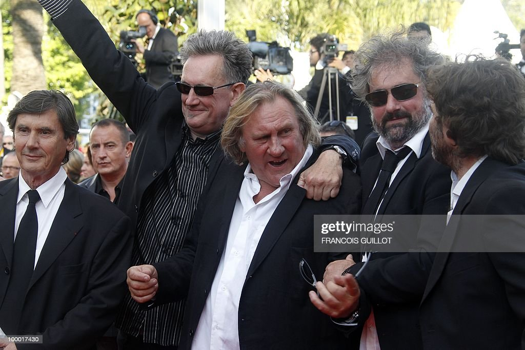 French actor Gerard Depardieu (C), actor and director Benoit Delepine (2ndL) and actor Gustave Kervern (2ndR) arrive for the screening of 'Fair Game' presented in competition at the 63rd Cannes Film Festival on May 20, 2010 in Cannes.