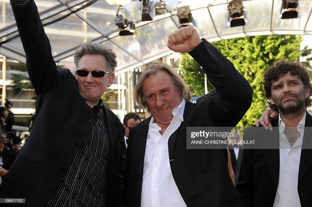 French actor Gerard Depardieu (C), actor and director Benoit Delepine (L) and Fred Poulet (R) arrive for the screening of 'Fair Game' presented in competition at the 63rd Cannes Film Festival on May 20, 2010 in Cannes.