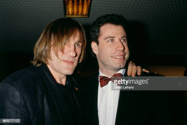 French actor Gerard Depardieu and American actor John Travolta attend the premiere of the movie Cyrano de Bergerac, based on the play by Edmond...