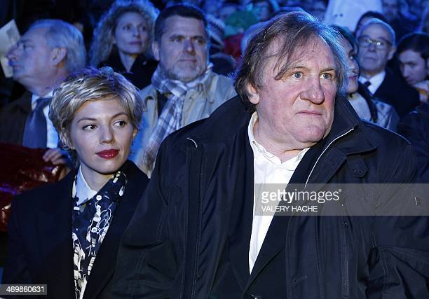 French actor Gerard Depardieu and his partner Clementine Igou attend the Nice Carnival parade on February 14 2014 in Nice southeastern France The...