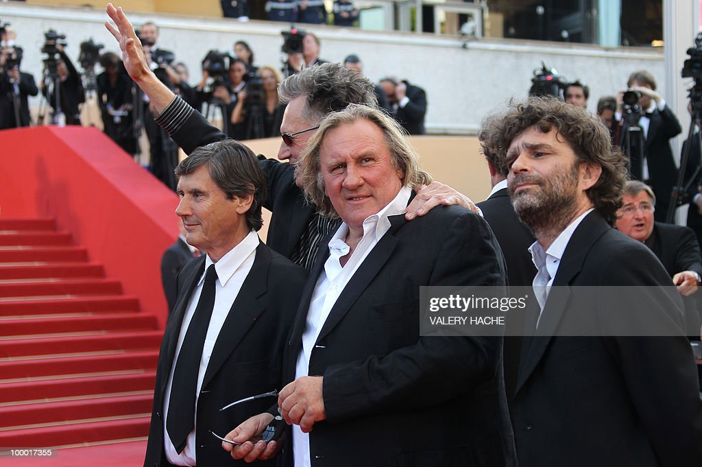 French actor Gerard Depardieu (C) arrives for the screening of 'Fair Game' presented in competition at the 63rd Cannes Film Festival on May 20, 2010 in Cannes.