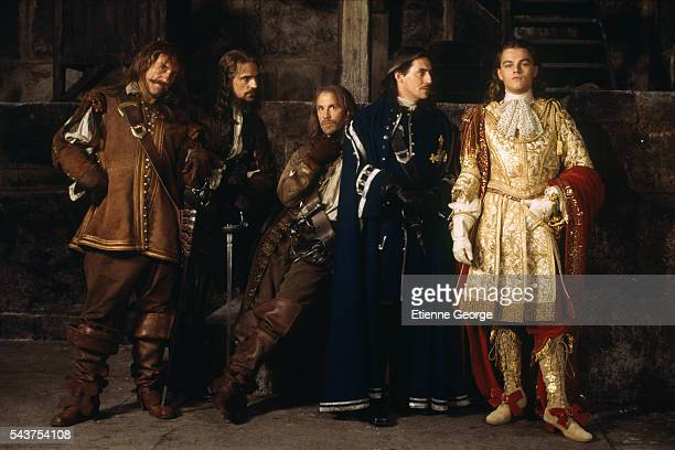 French actor Gerard Depardieu, British actor Jeremy Irons, American actor John Malkovich, Irish actor Gabriel Byrne and American actor Leonardo DiCaprio on the film set of 'The Man in the Iron Mask', directed by American director Randall Wallace and based on the novels 'Vingt Ans Apres' and 'Le Vicomte de Bragelonne', by French author Alexandre Dumas.