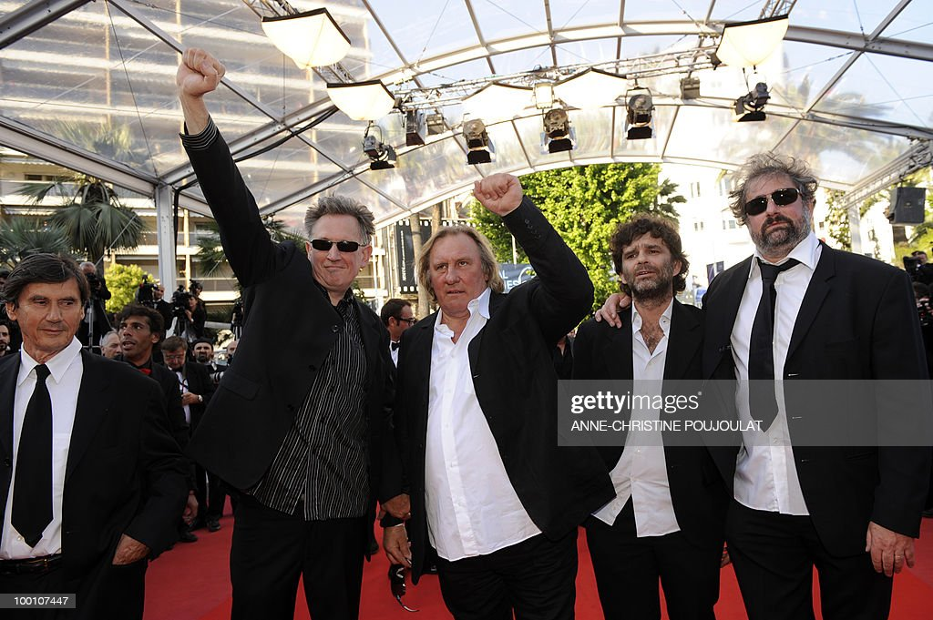 French actor Gerard Depardieu (3rdL), directors Benoit Delepine (2ndL) and Gustave Kervern (R) and Fred Poulet (2ndR) arrive for the screening of 'Fair Game' presented in competition at the 63rd Cannes Film Festival on May 20, 2010 in Cannes.
