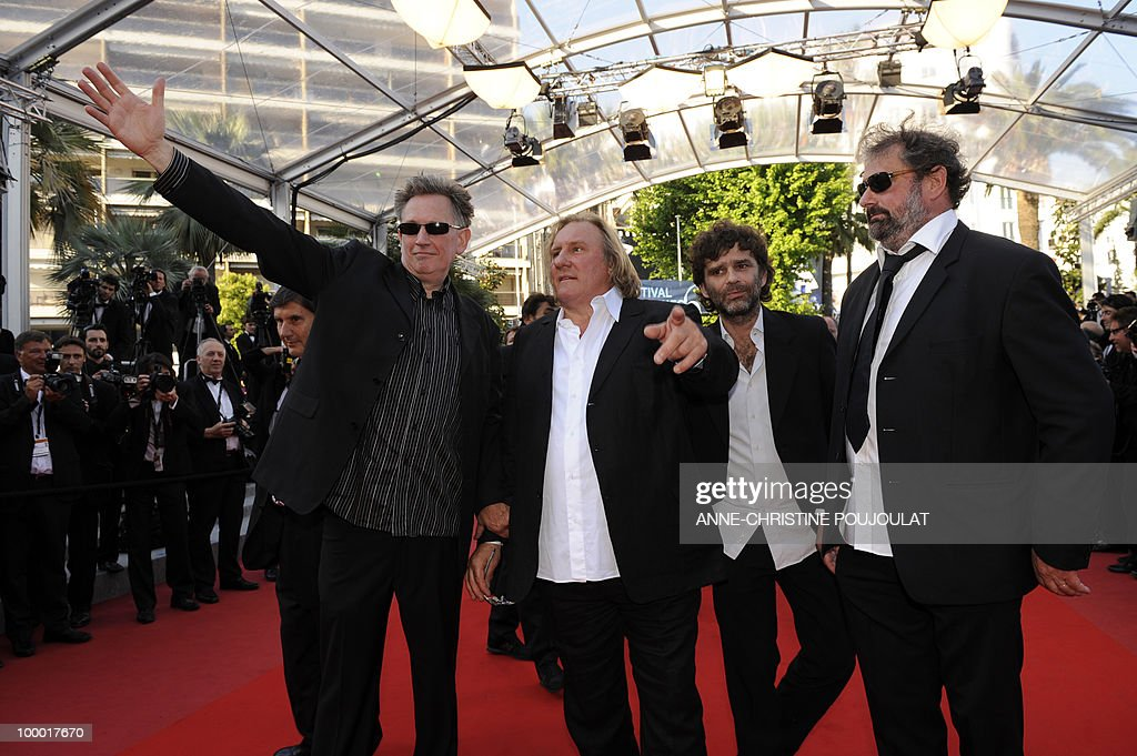 French actor Gerard Depardieu (2ndL), directors Benoit Delepine (L), Gustave Kervern (R) and Fred Poulet (2ndR) arrive for the screening of 'Fair Game' presented in competition at the 63rd Cannes Film Festival on May 20, 2010 in Cannes.