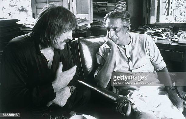 French actor Gerard Depardieu having a conversation with film director Satyajit Ray Ray is the preeminent filmmaker of India as well as an...