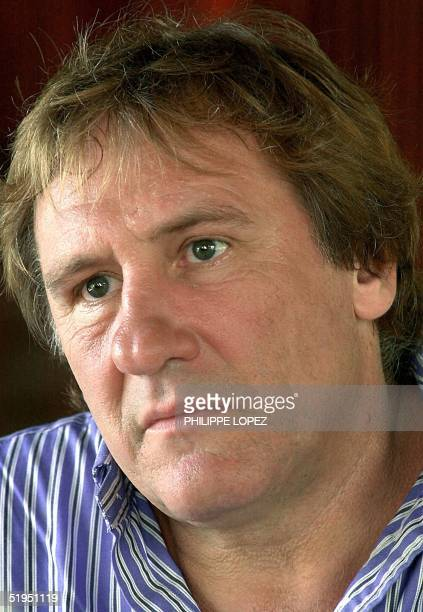 French actor Gerard Depardieu listens to a question during an interview after a visit to the Kantha Bopha paediatric hospital in Phnom Penh 01 June...