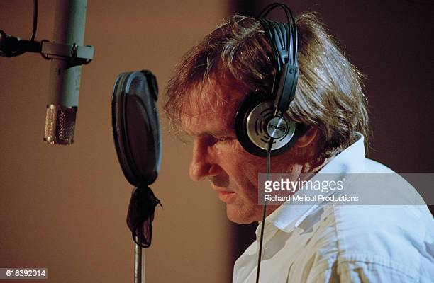 French actor Gerard Depardieu singing with Italian singer Zucchero in a recording studio