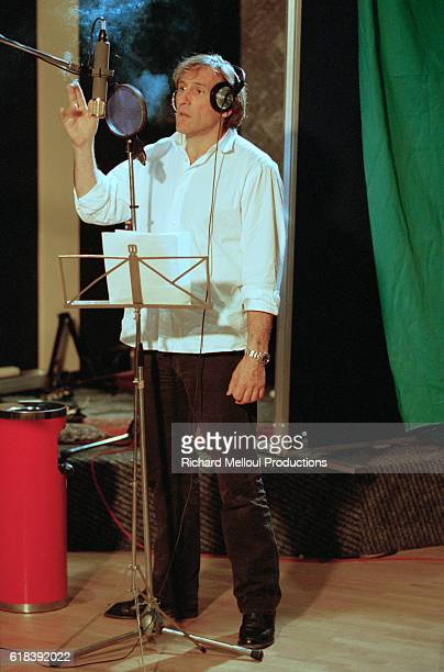 French actor Gerard Depardieu singing with Italian singer Zucchero in a recording studio