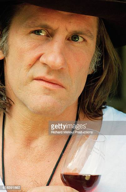 French actor Gerard Depardieu tasting a wine produced from his vineyard | Location Tigne France