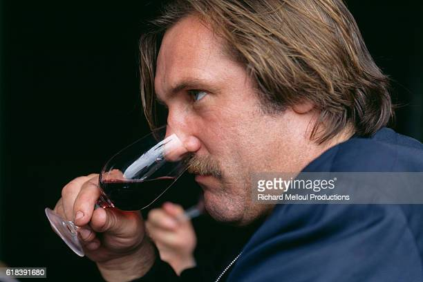 French actor Gerard Depardieu tasting wine from his vineyard | Location Tigne France
