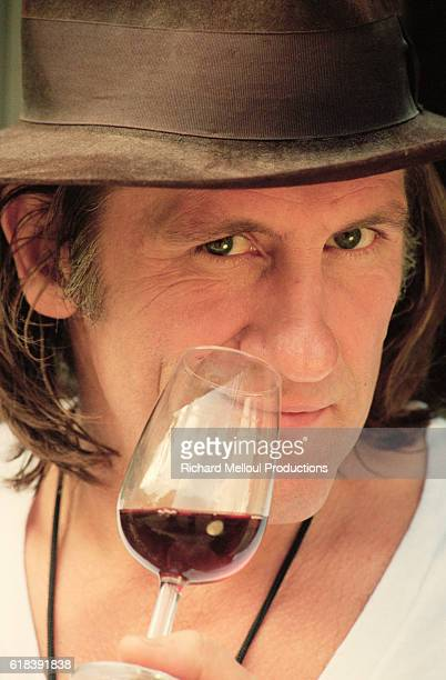 French actor Gerard Depardieu tasting wine on His vineyard | Location Tigne France