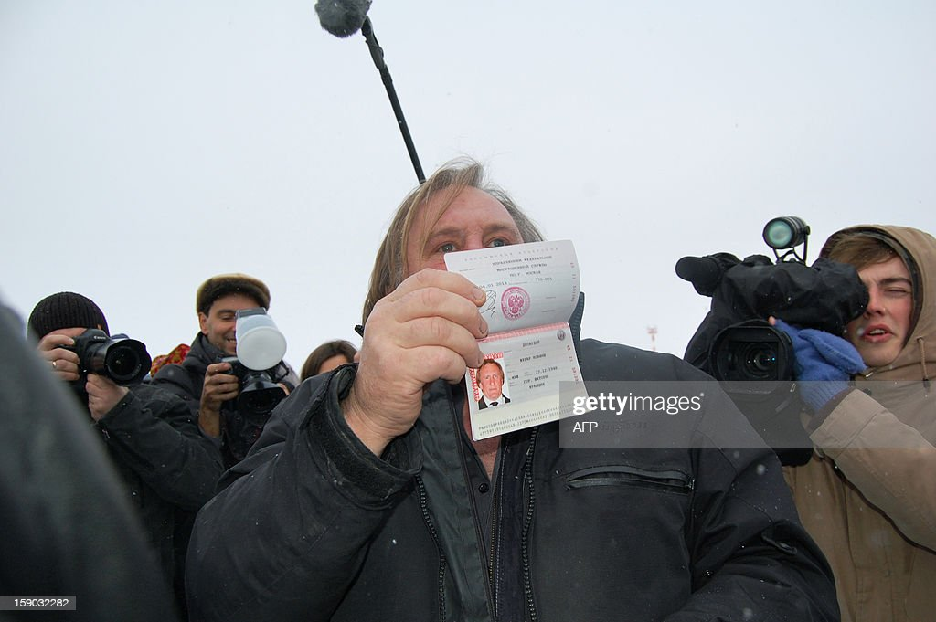 French actor Gerard Depardieu, who has threatened to quit his homeland to avoid higher taxes, shows off his new Russian passport on January 6, 2013 at Mordovia airport in Saransk where he has been offered residence in this central Russia region known for Stalin-era Gulag labour camps. The former Oscar nominee travelled to snow-covered Mordovia a day after he met with strongman President Vladimir Putin at his sumptuous Black Sea villa in the resort town of Sochi for friendly banter over a meal.