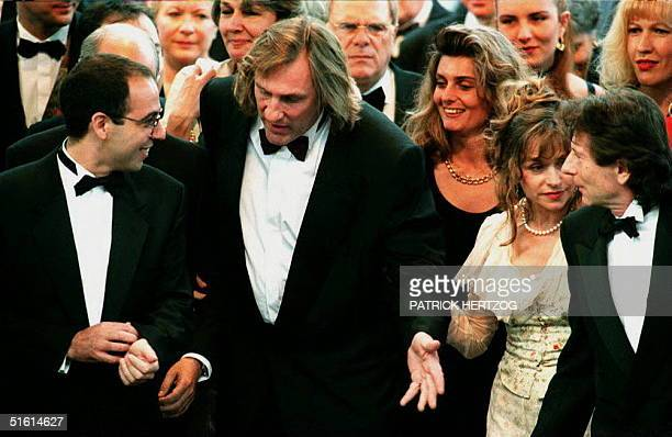 French actor Gerard Depardieu with his wife, Elisabeth on his arm, Italian director Giuseppe Tornatore and actor Roman Polanski climb the steps of...