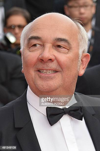 """French actor Gerard Jugnot poses as he arrives for the screening of the animated film """"How to train your Dragon 2"""" at the 67th edition of the Cannes..."""