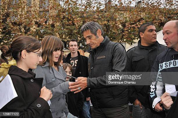 French Actor Gerard Lanvin signs autographs during a meeting at the rugby school of Sarlat during the 19th Festival du Film de Sarlat on November 9...