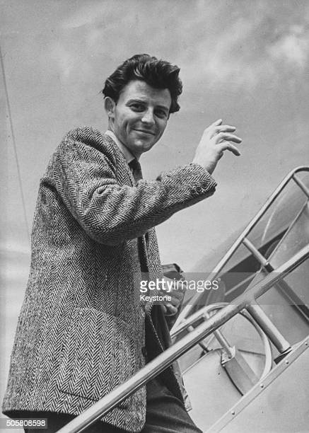 French actor Gerard Philipe waving as he boards a plane bound fro Rome where he will begin filming 'Beauty and the Devil' July 14th 1949