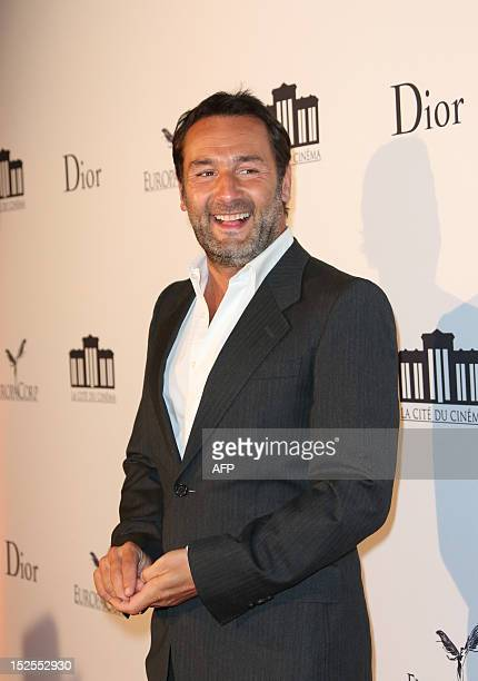 French actor Gilles Lellouche poses as he arrives to attend the inauguration ceremony of the Cite du cinema a film studios complex heralded as...