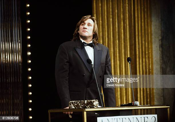 """French actor Gérard Depardieu at the César award ceremony receiving the prize for Best Actor for his role in """"Cyrano de Bergerac"""", directed by..."""