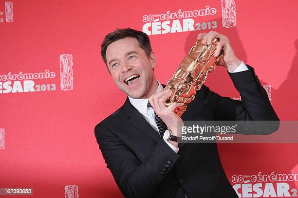 French actor Guillaume de Tonquedec poses with his trophy after receiving the Best Supporting Actor award during the Cesar Film Awards 2013 at...