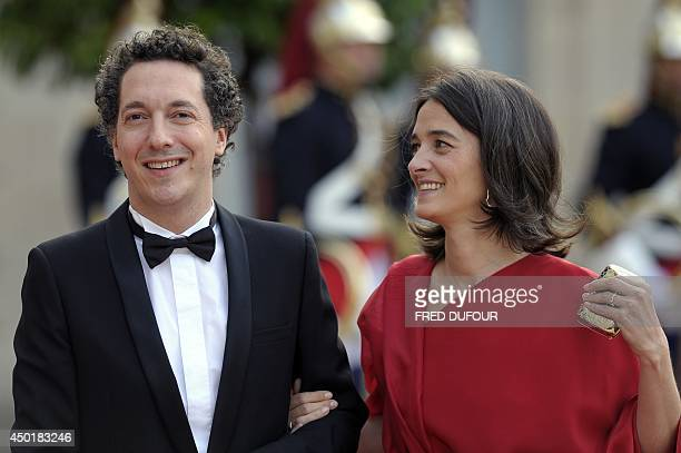 French actor Guillaume Gallienne and his wife Amandine Gallienne arrive for a state dinner with world leaders at the Elysee presidential palace in...