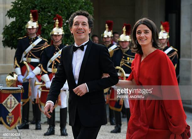 French actor Guillaume Gallienne and his wife Amandine Gallienne arrive for a state dinner at the Elysee presidential palace in Paris on June 6...