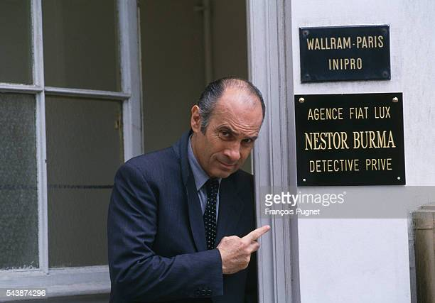 """French actor Guy Marchand on the set of the television series """"Nestor Burma"""", episode """"L'homme au sang bleu""""."""