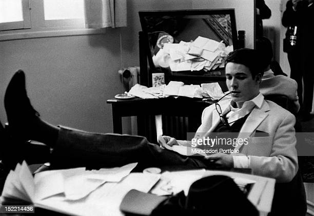 French actor Jacques Charrier reading in his study Paris 1959