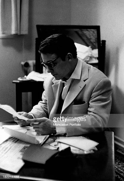 French actor Jacques Charrier reading sitting at his desk Paris 1959