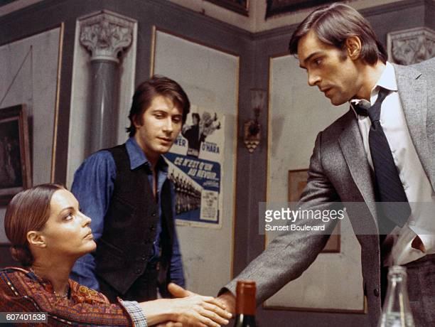 French actor Jacques Dutronc, Austrian-born German actress Romy Schneider and Italian actor Fabio Testi on the set of L'important c'est d'aimer...