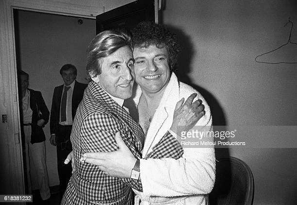 French actor Jacques Martin hugs actor Jean Lefebvre backstage at the Theatre de la Michodiere after performing his play Une Case de Vide Martin is a...