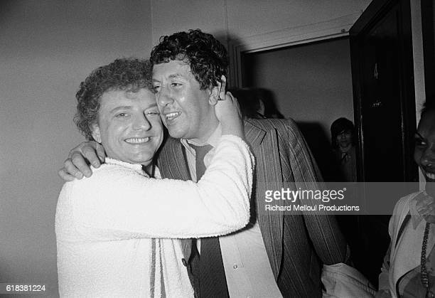 French actor Jacques Martin hugs actor Stephane Collaro backstage at the Theatre de la Michodiere after performing his play Une Case de Vide Martin...