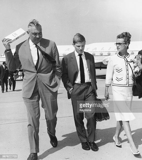French actor Jacques Tati and Jeanne Moreau arriving together in Rome, circa 1962.