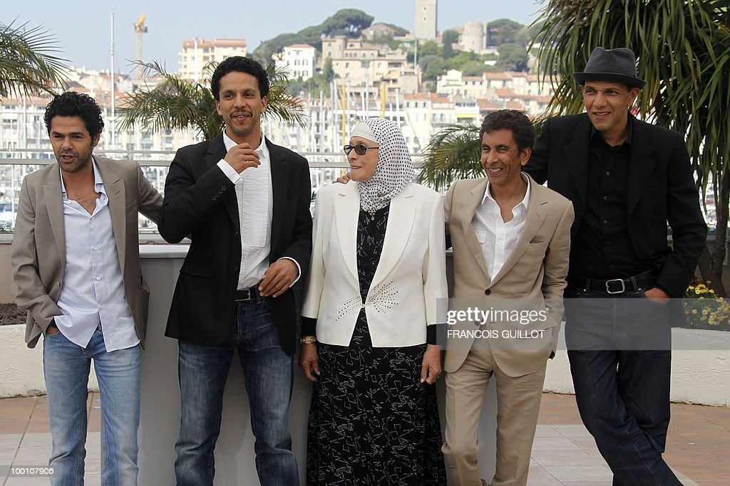 French actor Jamel Debbouze, French actor Sami Bouajila, actress Chafia Boudraa, French director Rachid Bouchareb and French actor Roschdy Zem pose during the photocall of 'Hors La Loi' (Outside of the Law) presented in competition at the 63rd Cannes Film Festival on May 21, 2010 in Cannes.