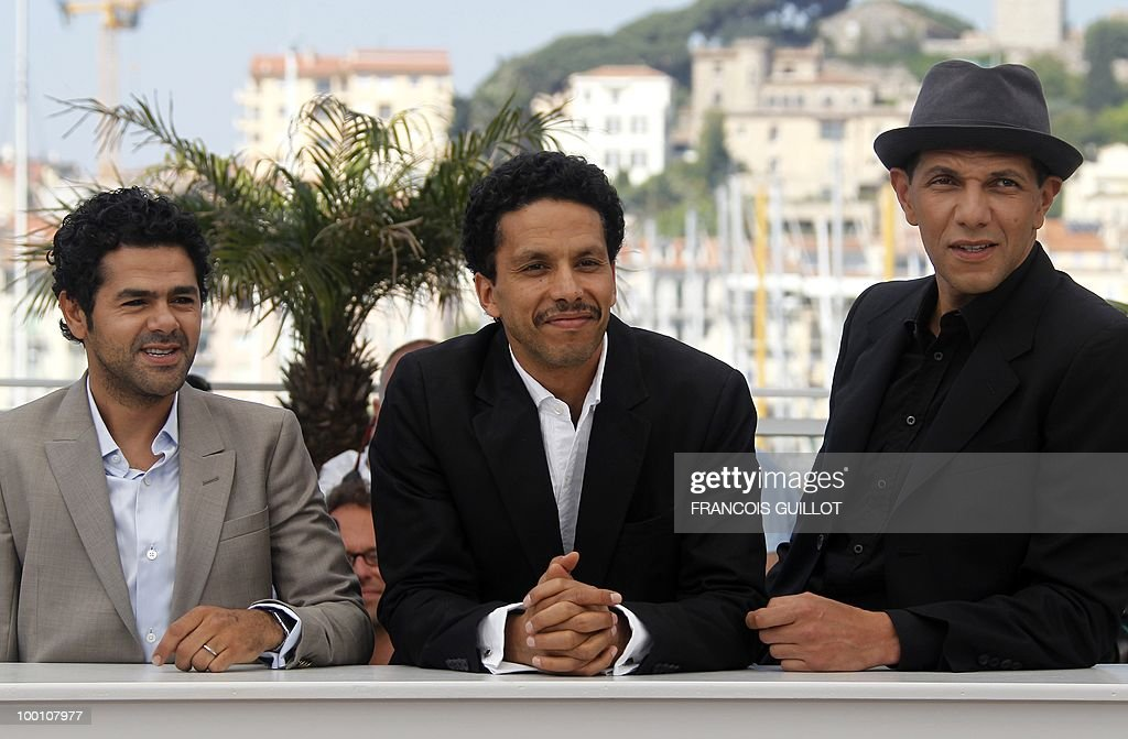 French actor Jamel Debbouze, French actor Sami Bouajila and French actor Roschdy Zem pose during the photocall of 'Hors La Loi' (Outside of the Law) presented in competition at the 63rd Cannes Film Festival on May 21, 2010 in Cannes.
