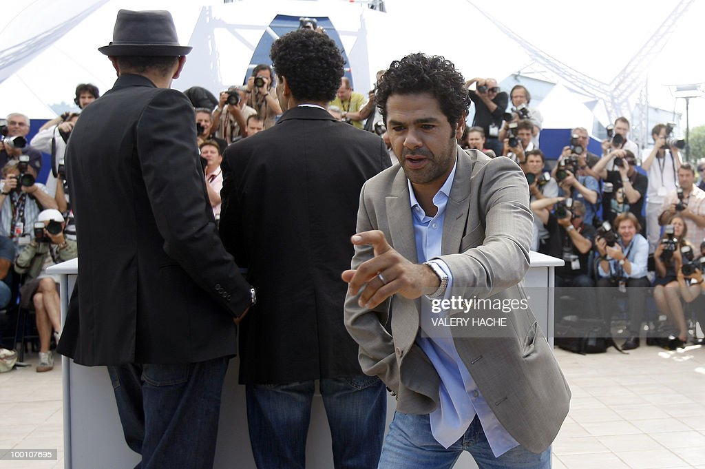 French actor Jamel Debbouze grabs a camera from a photographer as he poses during the photocall of 'Hors La Loi' (Outside of the Law) presented in competition at the 63rd Cannes Film Festival on May 21, 2010 in Cannes.