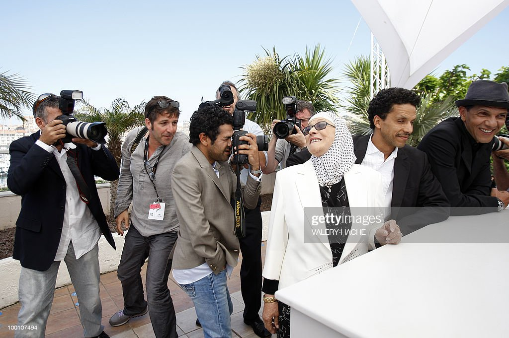 French actor Jamel Debbouze (C) pretends