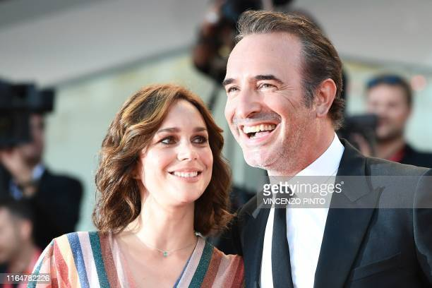 """French actor Jean Dujardin and his wife French ice dancer Nathalie Pechalat arrive for the screening of the film """"J'Accuse"""" presented in competition..."""