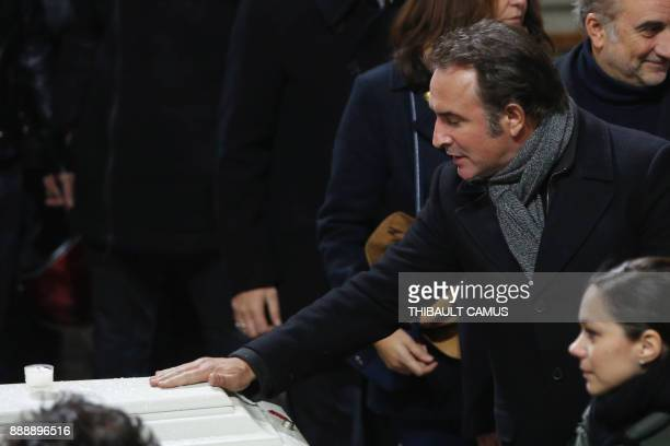 French actor Jean Dujardin pays his last respects during the funeral service of French musician Johnny Hallyday at La Madeleine Church in Paris on...