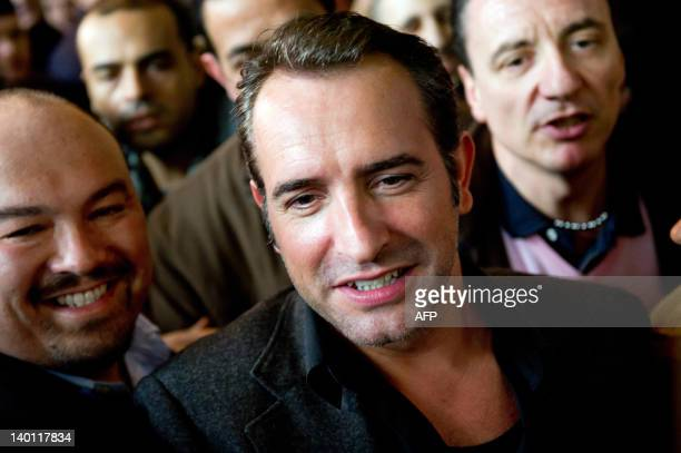 French actor Jean Dujardin winner of the Oscar for best actor for his role in silent movie The Artist arrives at Roissy Charles de Gaulle airport on...