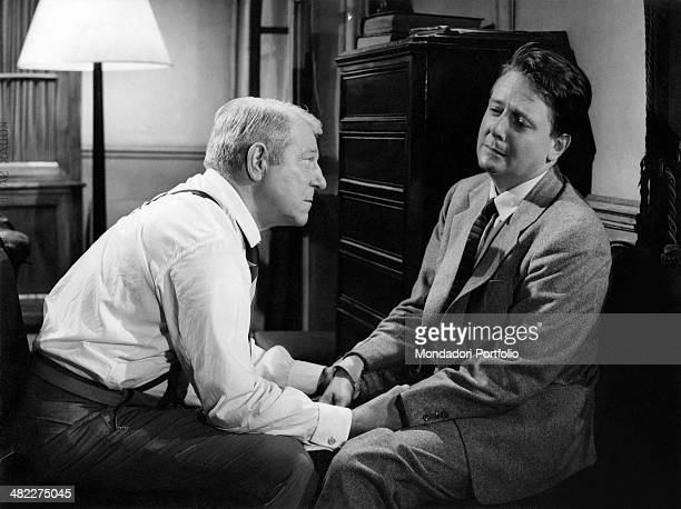 French actor Jean Gabin as Maigret questioning French actor Jean Desailly in the film Inspector Maigret. France, 1958