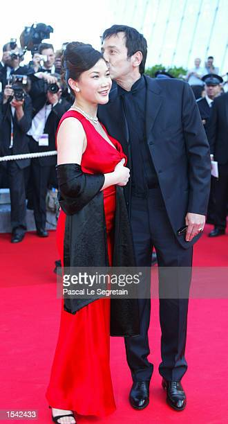 French actor Jean Hugues Anglade and an unidentified companion arrive for the opening ceremony at the 55th International Film Festival May 15 2002 in...