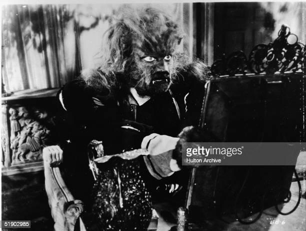 French actor Jean Marais as la Bete looks at himself in a mirror in a scene from the film 'La Belle et la Bete' directed by Jena Cocteau 1946