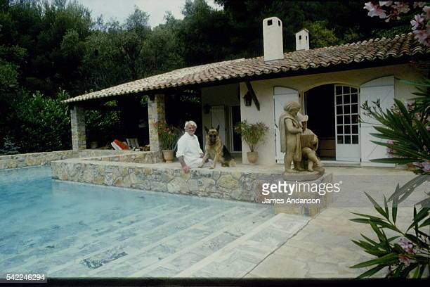 French actor Jean Marais with his dog outside his villa in Vallauris