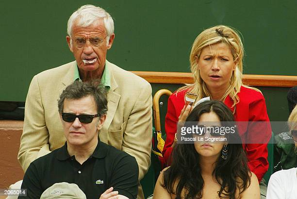 French Actor Jean Paul Belmondo and his wife Nathy watch the mens final match beween Juan Carlos Ferrero of Spain and Martin Verkerk of the...